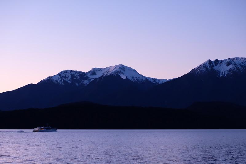 Night view of boat on Lake Te Anau, South Island New Zealand