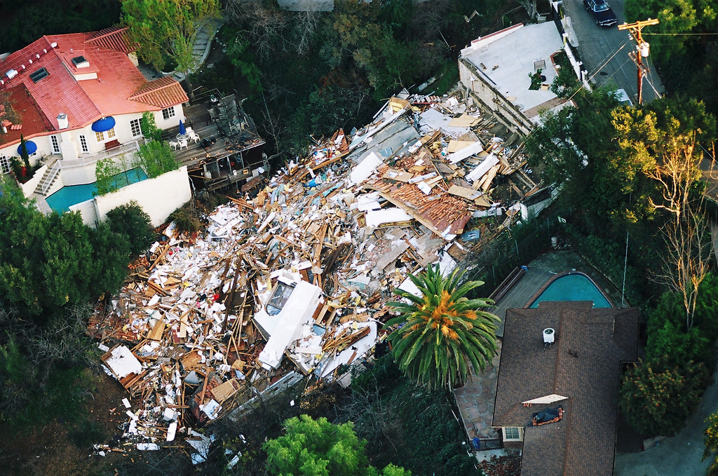 . A home on Sunswept Drive in Studio City was flattened after the quake sent it plunging down the hillside.   Los Angeles Daily News file photo