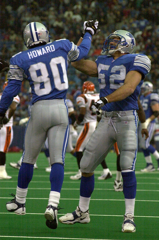 . Detroit Lions players Desmond Howard (80) and Scott Kowalkowski (52) celebrate after Howard returned the ball to the goal line against the Cincinnati Bengals during Sunday\'s game played at the Pontiac Silverdome. The Lions lost 31-27 to the Bengals.