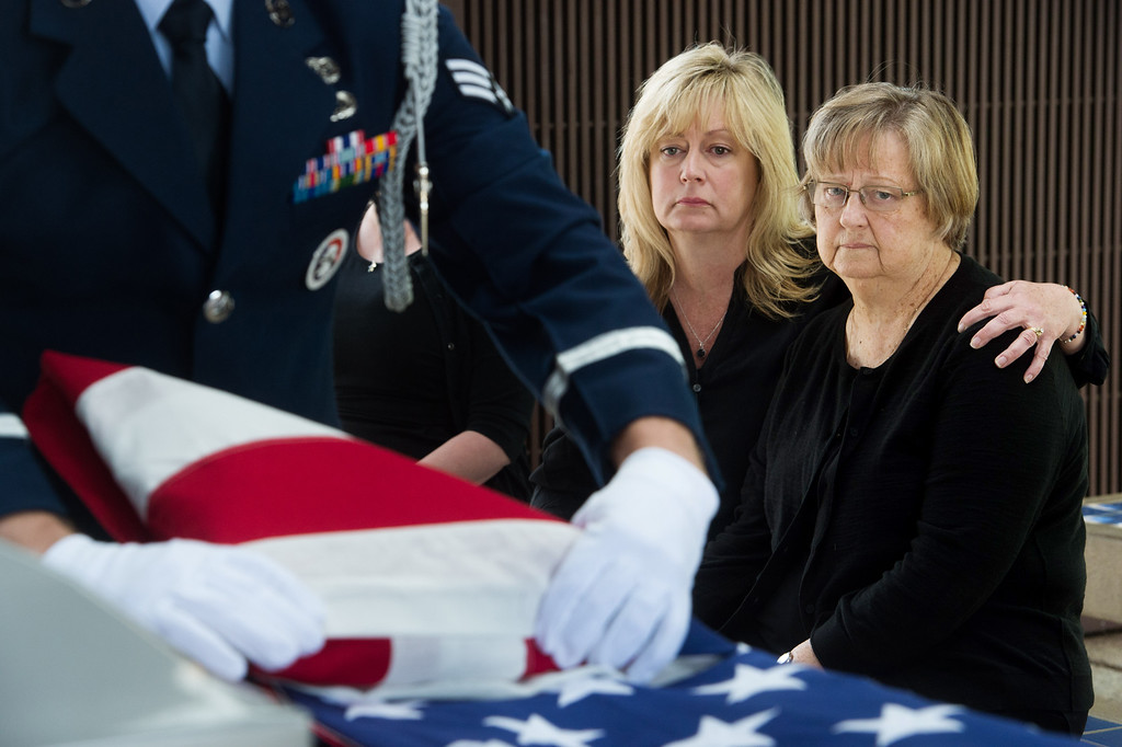 . Brittarose Morgan, 77, right, wife of the late Airman First Class Roland Morgan with daughter, Kym Carmichael, watch the U.S. flag being folded by Senior Airman Joseph Trujillo of the Blue Eagles Honor Guard at Riverside National Cemetery in Riverside, Calif. on Tuesday, May 19, 2015. (Photo by Watchara Phomicinda/ Los Angeles Daily News)