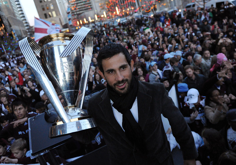 . Colorado Rapids captain Pablo Mastroeni holds up the trophy and celebrates winning of 2010 MLS championship with the fans at Skyline Park on Tuesday. November 20, 2010. Hyoung Chang/ The Denver Post