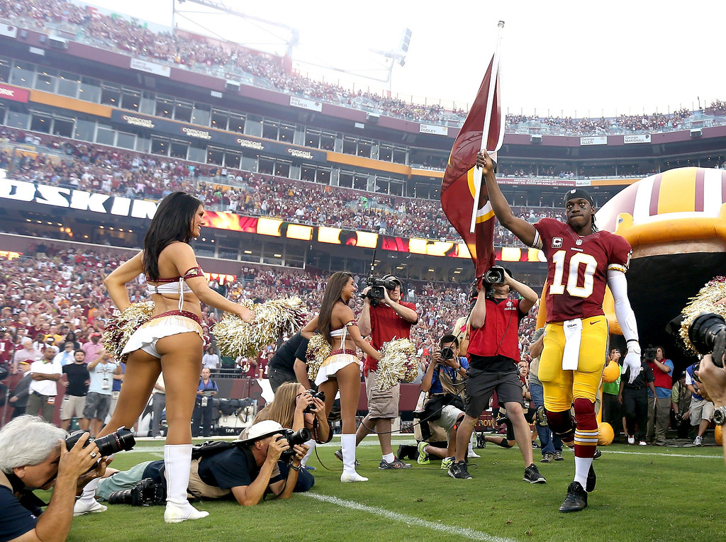 . Puarterback Robert Griffin III #10 of the Washington Redskins leads the team out onto the field before taking on the Philadelphia Eagles at FedExField on September 9, 2013 in Landover, Maryland.  (Photo by Rob Carr/Getty Images)