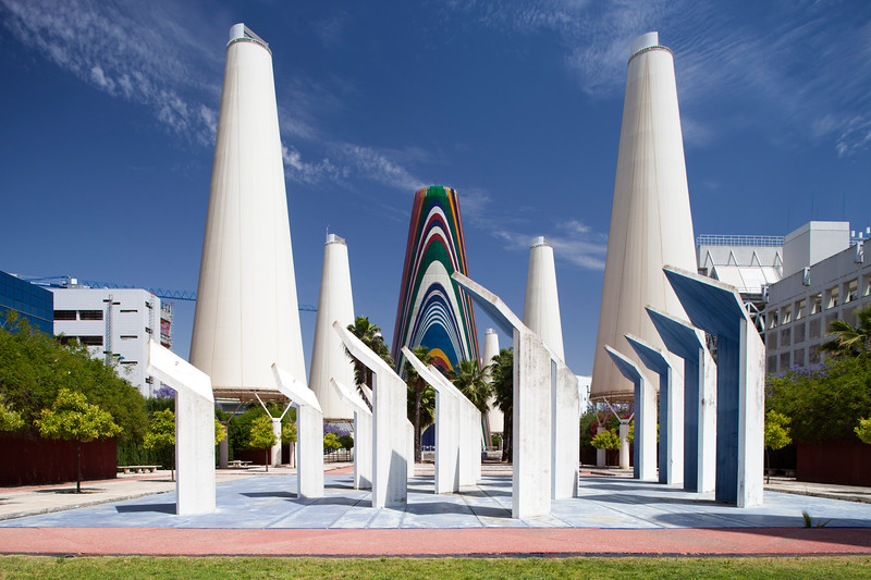 Avenue of Europe, which features twelve massive white-coloured towers, and a central multi-coloured tower featuring the flags of the twelve nations of the European Union in 1992, Expo 92, Seville, Spain
