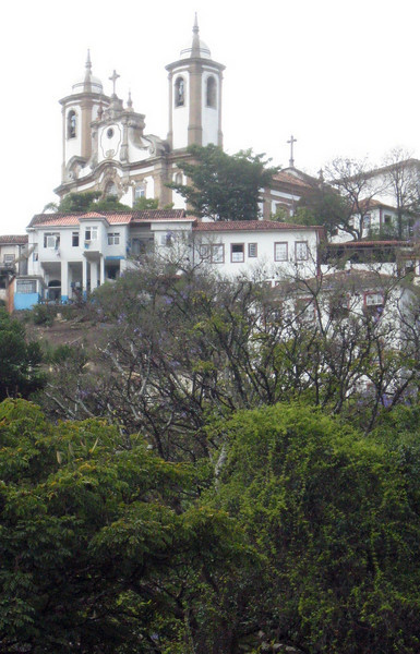 A view from far below toward Matriz de Nossa Senhora do Pilar, an opulent Brazilian Baroque church.