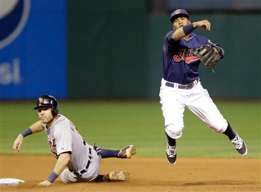 . Cleveland Indians\' Jose Ramirez, right, looks toward first base after getting Detroit Tigers\' Ian Kinsler, left, out at second base in the sixth inning of a baseball game, Tuesday, Sept. 2, 2014, in Cleveland. Torii Hunter was out at first base on the play for the double play. (AP Photo/Tony Dejak)