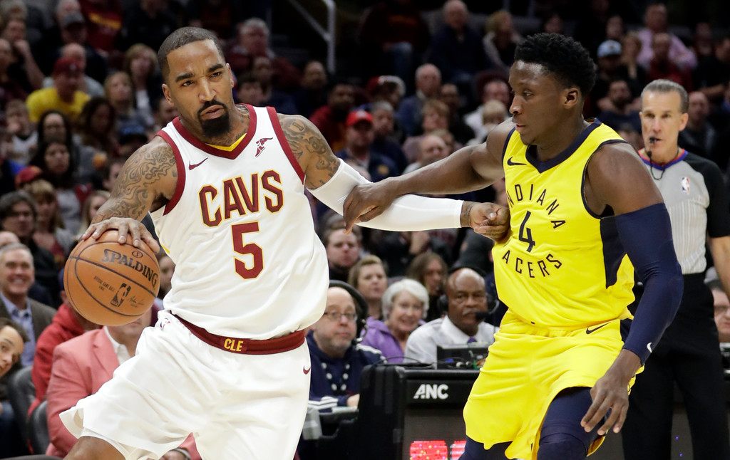 . Cleveland Cavaliers\' JR Smith (5) drives past Indiana Pacers\' Victor Oladipo (4) in the first half of an NBA basketball game, Friday, Jan. 26, 2018, in Cleveland. (AP Photo/Tony Dejak)