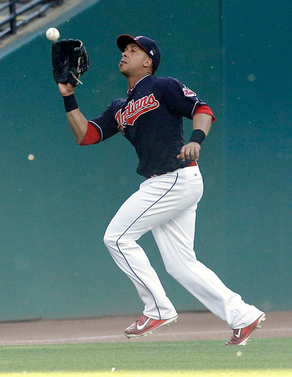 . Cleveland Indians\' Michael Brantley catches a ball hit by Oakland Athletics\' Jed Lowrie in the fifth inning of a baseball game, Wednesday, May 31, 2017, in Cleveland. Lowrie was out on the play. (AP Photo/Tony Dejak)