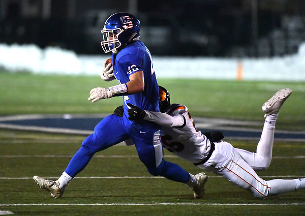 12/4/2019 Mike Orazzi | StaffrSouthingtons Dillon Kohl (42) during the Class LL football playoff with Ridgefield at Southington High School on Wednesday night.