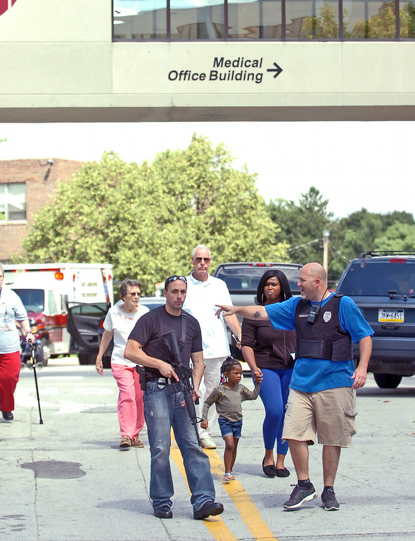 . Police evacuate people from the Sister Marie Lenahan Wellness Center in Yeadon on the campus of Mercy Fitzgerald Hospital after a shooting Thursday. (Times Staff / JULIA WILKINSON )