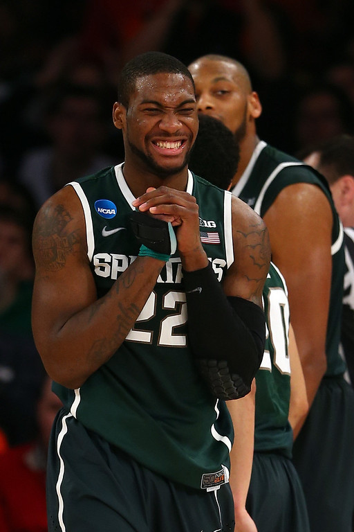 . Branden Dawson #22 of the Michigan State Spartans reacts against the Virginia Cavaliers during the regional semifinal of the 2014 NCAA Men\'s Basketball Tournament at Madison Square Garden on March 28, 2014 in New York City.  (Photo by Elsa/Getty Images)