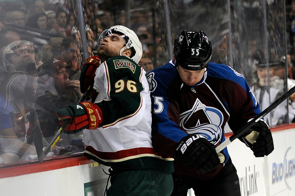 . Cody McLeod (55) of the Colorado Avalanche checks Pierre-Marc Bouchard (96) of the Minnesota Wild into the boards during the first period, Saturday, April 27, 2012 at Pepsi Center. Seth A. McConnell, The Denver Post
