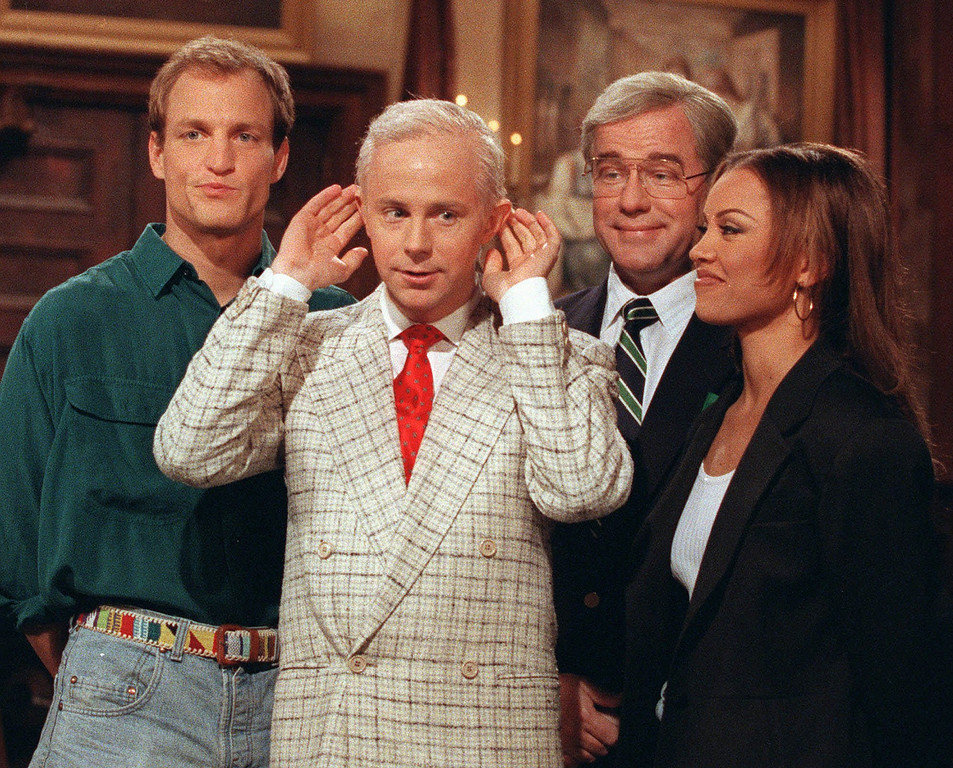 . Actor Woody Harrelson, left, and entertainer Vanessa Williams, right, join Saturday Night Live regulars Dana Carvey, dressed as Johnny Carson, center, and Phil Hartman, dressed as Ed McMahon, for a taping of Saturday Night Live in this May 15, 1992 photo. (AP Photo/Alex Brandon)