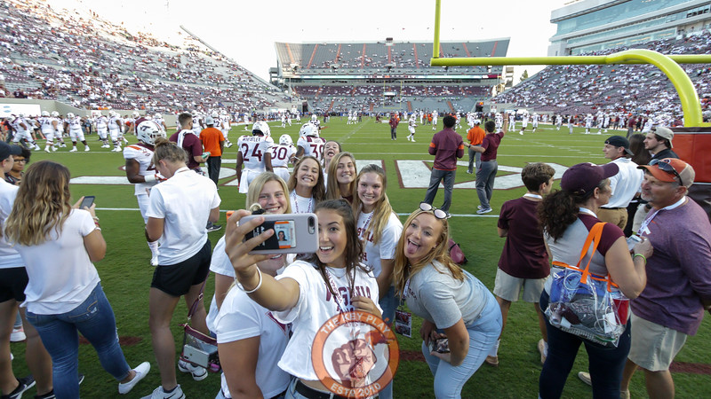 A group of Virginia Tech fans pose for a selfie on the field during pre-game warmups. (Mark Umansky/TheKeyPlay.com)