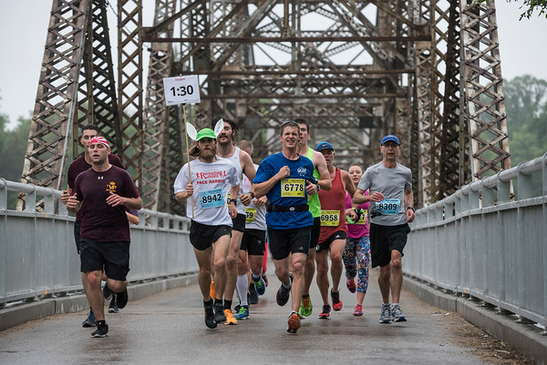 DAVID LIPNOWSKI / WINNIPEG FREE PRESS  Half Marathon participants run over the Elm Park Bridge Sunday June 18, 2017.