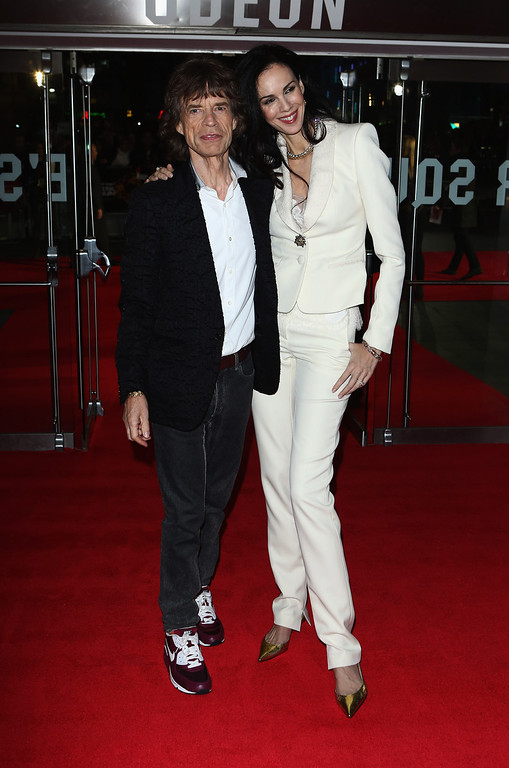 . Mick Jagger of the Rolling Stones and L\'Wren Scott attend the Premiere of \'Crossfire Hurricane\' during the 56th BFI London Film Festival at Odeon Leicester Square on October 18, 2012 in London, England.  (Photo by Tim Whitby/Getty Images for BFI)
