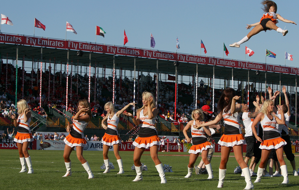 Description of . Cheerleaders dance at half-time during the Women's Sevens Challenge Cup semi-final match between Australia and England in the Gulf emirate of Dubai on December 3, 2011. AFP PHOTO/MARWAN NAAMANI