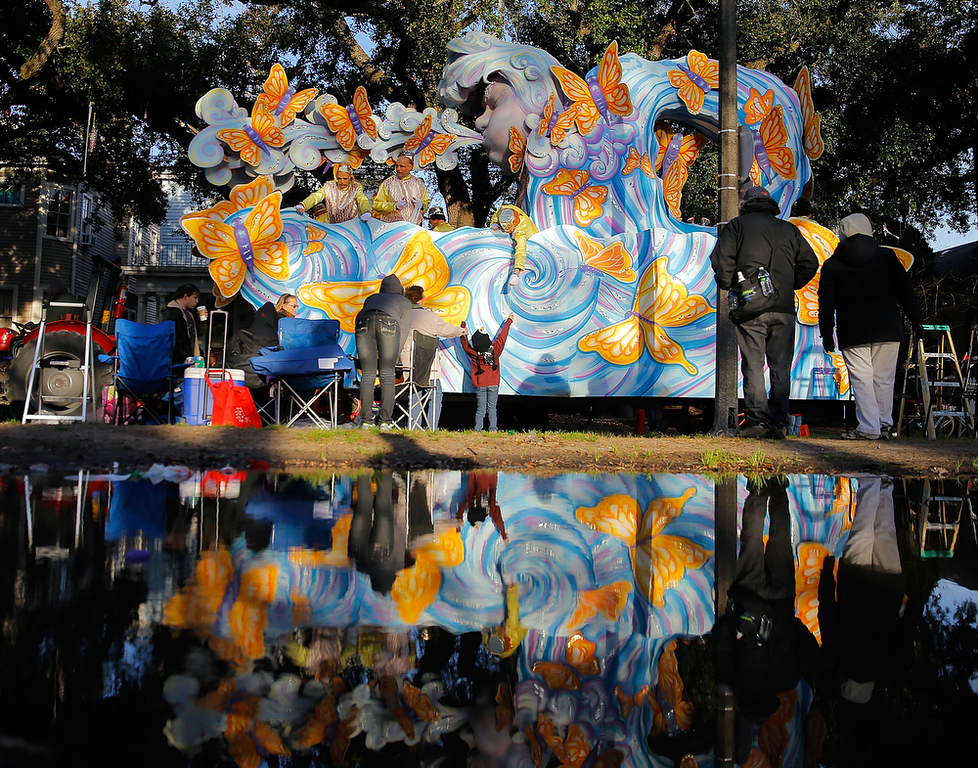 ". The Krewe of Proteus rolls uptown on Lundi Gras, Monday, March 3, 2014, in New Orleans. The 20-float parade depicted the theme ""Ancient Elements of Alchemy.\"" The identity of the oldest night parade\'s monarch always remains secret. (AP Photo/NOLA.com The Times-Picayune, David Grunfeld)"