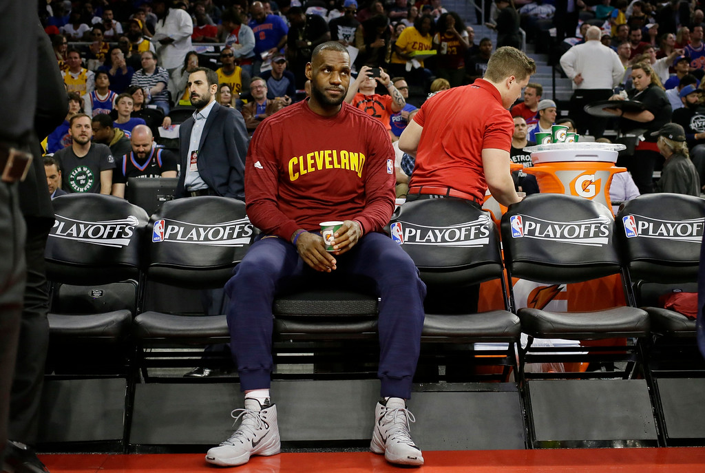. Cleveland Cavaliers forward LeBron James waits on the bench before the first half in Game 4 of a first-round NBA basketball playoff series against the Detroit Pistons, Sunday, April 24, 2016 in Auburn Hills, Mich. (AP Photo/Carlos Osorio)