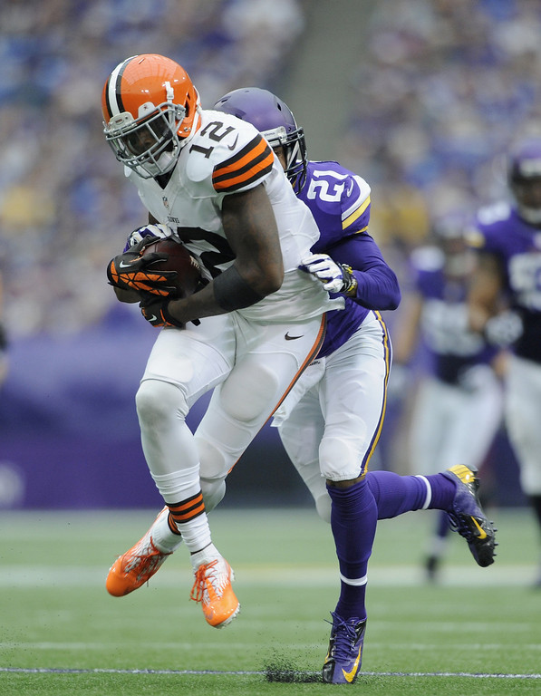 . Josh Robinson #21 of the Minnesota Vikings tackles Josh Gordon #12 of the Cleveland Browns during the second quarter of the game on September 22, 2013 at Mall of America Field at the Hubert H. Humphrey Metrodome in Minneapolis, Minnesota. (Photo by Hannah Foslien/Getty Images)