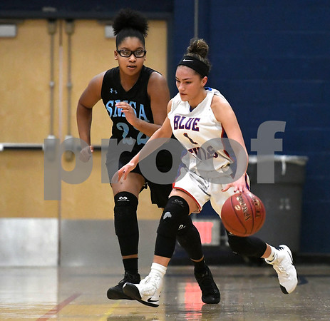 12/28/2017 Mike Orazzi | Staff Plainville's Amiyah Peters (1) and SMSA's Chyna Jones (22) during the Rybczyk Memorial Holiday Basketball Tournament at Plainville High School Thursday afternoon.