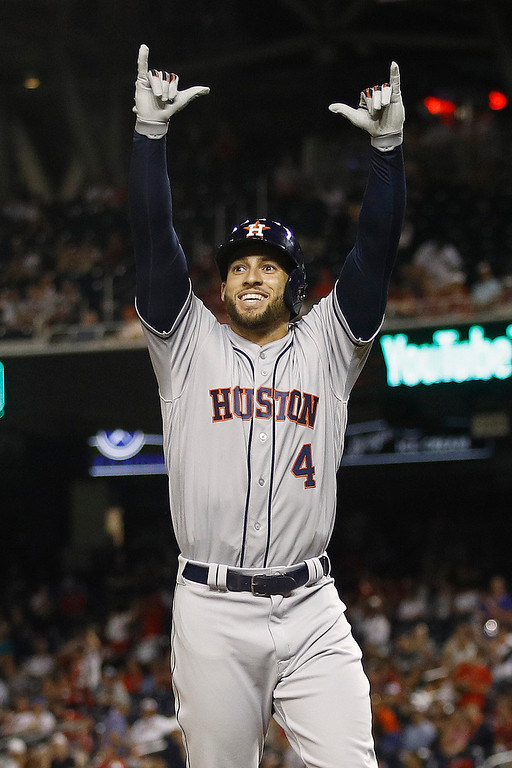 . Houston Astros outfielder George Springer (4) celebrates his solo home run in the tenth inning during the Major League Baseball All-star Game, Tuesday, July 17, 2018 in Washington. (AP Photo/Patrick Semansky)