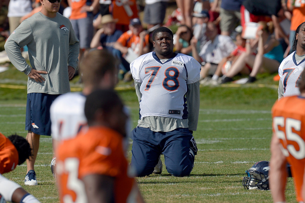 . Denver Broncos T Ryan Clady (78) stretches during training camp August 6, 2013 at Dove Valley. (Photo By John Leyba/The Denver Post)