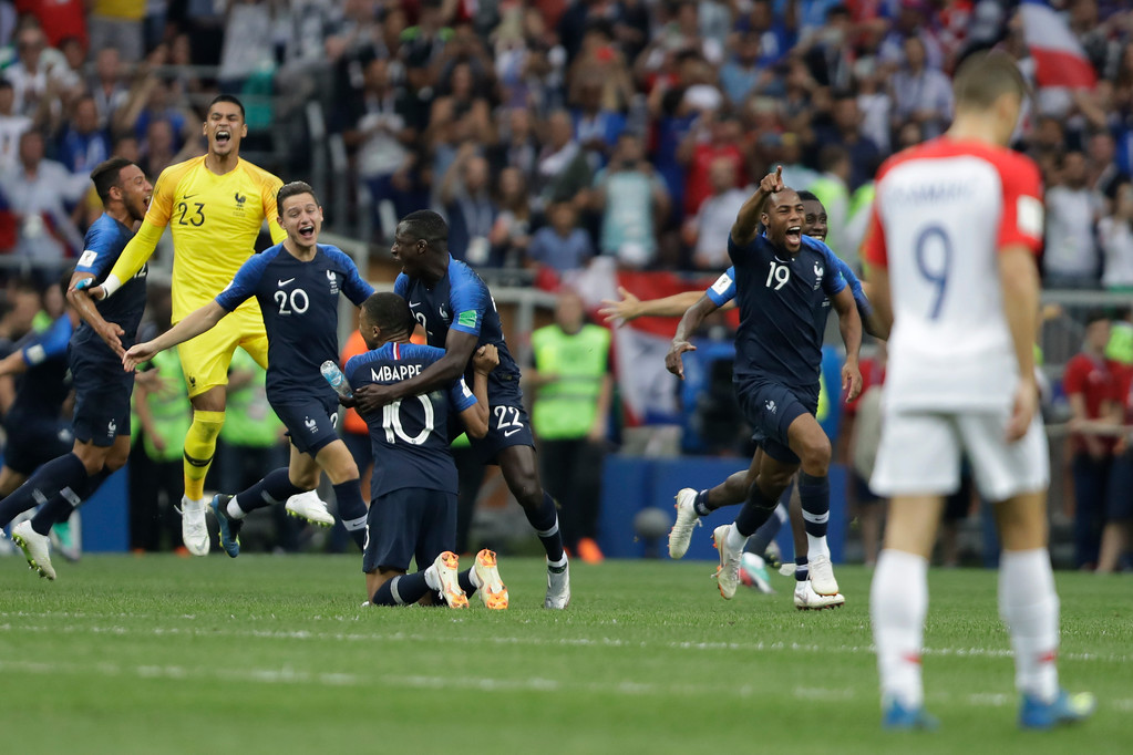 . French players celebrate winning the final match against Croatia at the 2018 soccer World Cup in the Luzhniki Stadium in Moscow, Russia, Sunday, July 15, 2018. (AP Photo/Natacha Pisarenko)