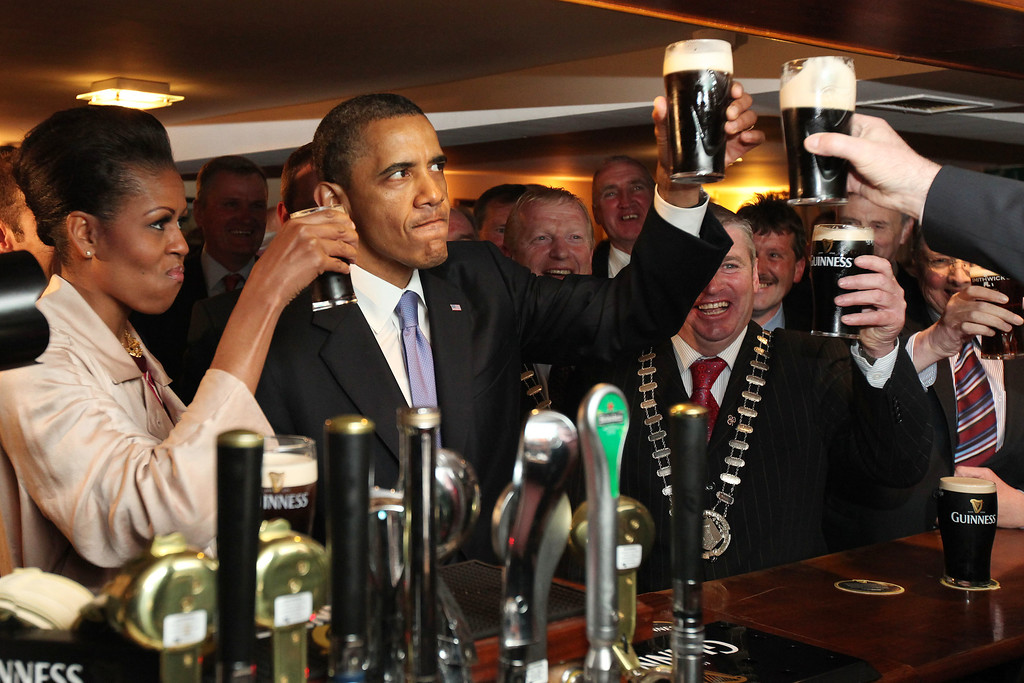 . U.S. President Barack Obama and first lady Michelle Obama drink Guinness beer as they meet with local residents at Ollie Hayes pub in Moneygall, Ireland, the ancestral homeland of his great-great-great grandfather, Monday, May 23, 2011. (AP Photo, Pool)