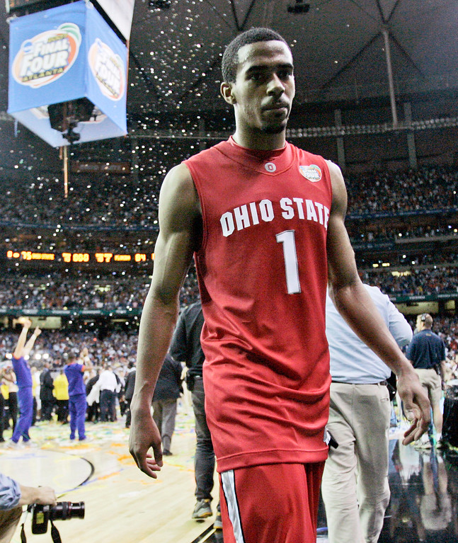 . Ohio State guard Mike Conley Jr. (1) walks off the court after losing 84-75 to Florida in the  men\'s championship basketball game at the Final Four in the Georgia Dome in Atlanta Monday, April 2, 2007. (AP Photo/Mark Humphrey)