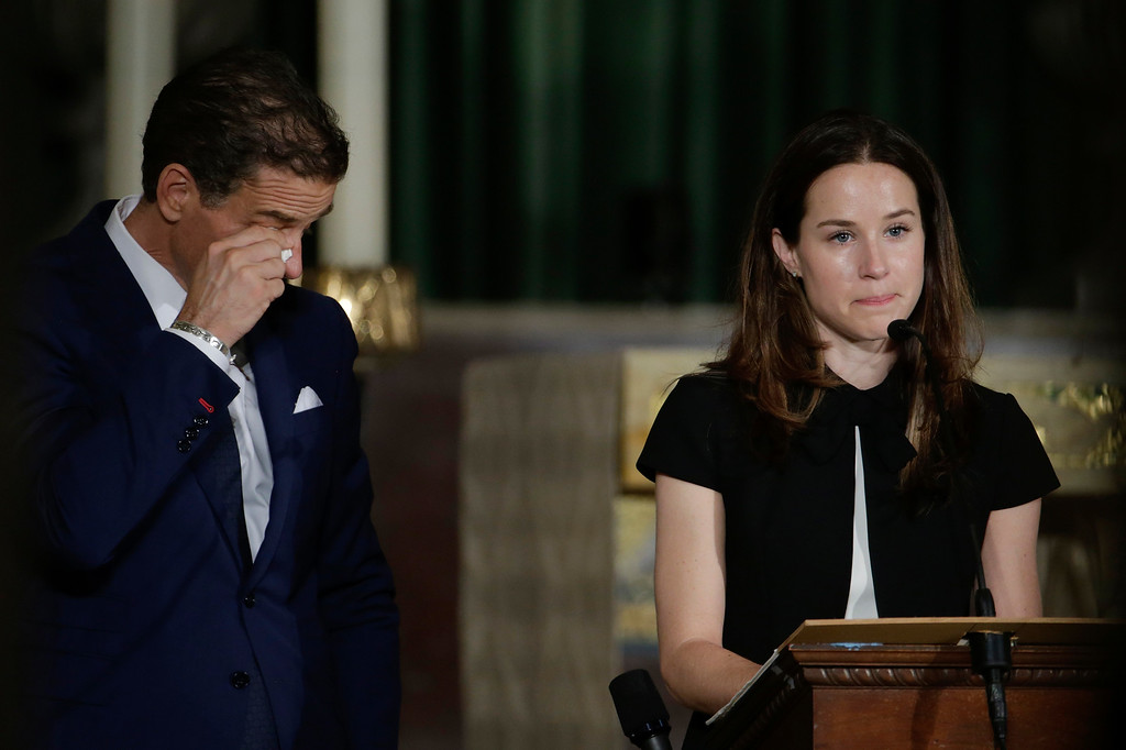 . Hunter Biden wipes his eyes as his sister Ashley delivers the eulogy for their brother, former Delaware Attorney General Beau Biden, Saturday, June 6, 2015, at St. Anthony of Padua Church in Wilmington, Del. Biden, the vice president\'s eldest son, died at the age of 46 after a battle with brain cancer. (AP Photo/Pablo Martinez Monsivais, Pool)