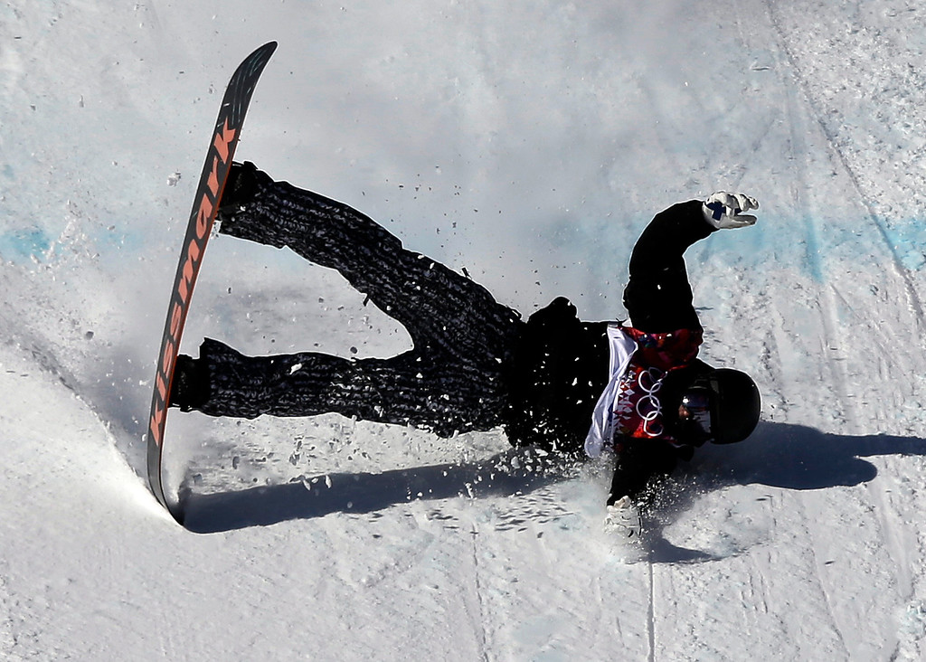 . Finland\'s Janne Korpi crashes during the men\'s snowboard slopestyle qualifying at the Rosa Khutor Extreme Park ahead of the 2014 Winter Olympics, Thursday, Feb. 6, 2014, in Krasnaya Polyana, Russia.  (AP Photo/Andy Wong)