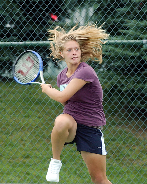 jhtennis1 - Kate Hartman watches her return shot during a recent practice at Palmyra-Macedon.