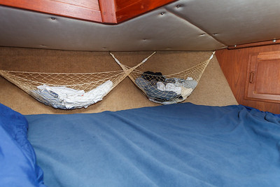Storage hammocks hang from both sides of my berth in the bow of the boat