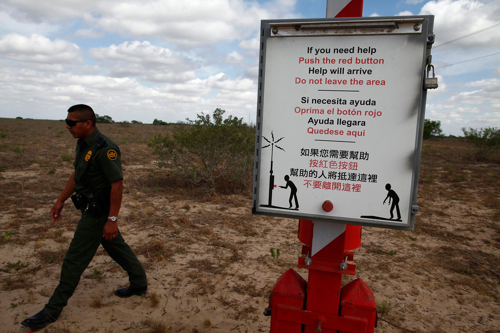 ". A U.S. Border Patrol agent walks past a rescue beacon near Falfurrias, Texas March 29, 2013. Brooks County has become an epicentre for illegal immigrant deaths in Texas. In 2012, sheriff\'s deputies found 129 bodies there, six times the number recorded in 2010. Most of those who died succumbed to the punishing heat and rough terrain that comprise the ranch lands of south Texas. Many migrants spend a few days in a ""stash house\"", such as the Casa del Migrante, in Reynosa, Mexico, and many are ignorant of the treacherous journey ahead. Picture taken March 29, 2013. REUTERS/Eric Thayer"