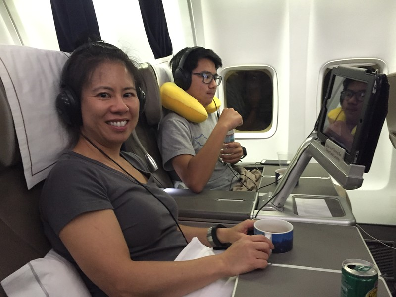 Smiling... happy with the free upgrade to business class.