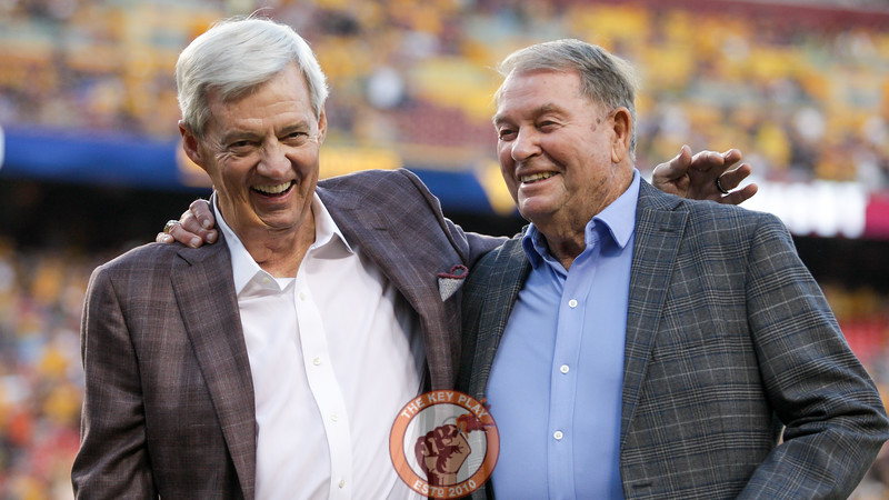 Former Virginia Tech head coach Frank Beamer and former West Virginia head coach Don Nehlen share a laugh on the field before the game. The two were named honorary captains for the game. (Mark Umansky/TheKeyPlay.com)