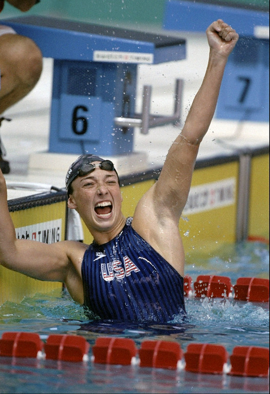 . Amy Van Dyken of the USA celebrates after winning the women\'\'s 50 meter freestyle at the Olympic Games at the Georgia Tech Aquatic Center in Atlanta, Georgia, July 26, 1996.