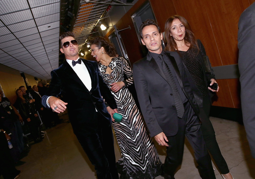 . Singer Robin Thicke (L), actress Paula Patton, singer Marc Anthony and guest attend the 56th GRAMMY Awards at Staples Center on January 26, 2014 in Los Angeles, California.  (Photo by Christopher Polk/Getty Images)