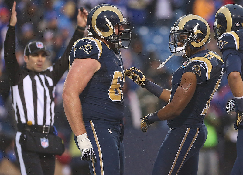 . Brandon Gibson #11 of the St. Louis Rams celebrates his touchdown with Harvey Dahl #62 during an NFL game against the Buffalo Bills at Ralph Wilson Stadium on December 9, 2012 in Orchard Park, New York. (Photo by Tom Szczerbowski/Getty Images)