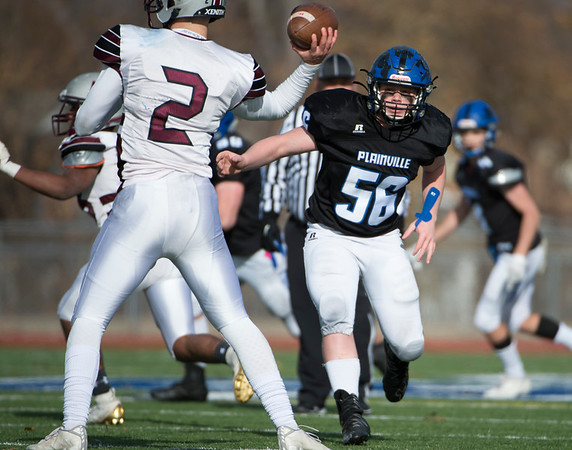 11/28/19 Wesley Bunnell | StaffrrPlainville football defeated Farmington on Thanksgiving morning at Plainville High School. Alexander Santini (56).