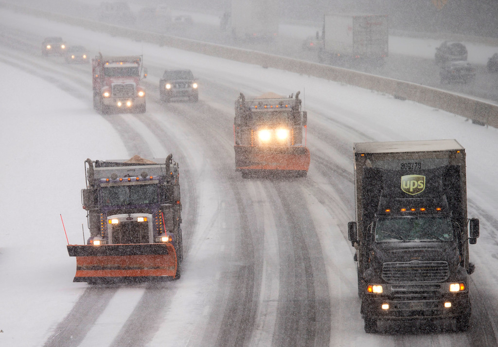 . Snow plows and traffic make their way north along Interstate 95 as snow begins to fall in Ashland, Va., Friday, Jan. 22, 2016. Portions of Virginia are under a blizzard warning. (AP Photo/Steve Helber)