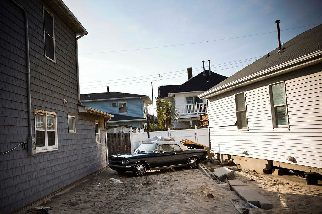 . A vintage car is seen between two houses in the Ortley Beach area of Toms River, New Jersey, which was heavily damaged by Hurricane Sandy, November 28, 2012. The storm made landfall along the New Jersey coastline on October 29. REUTERS/Andrew Burton