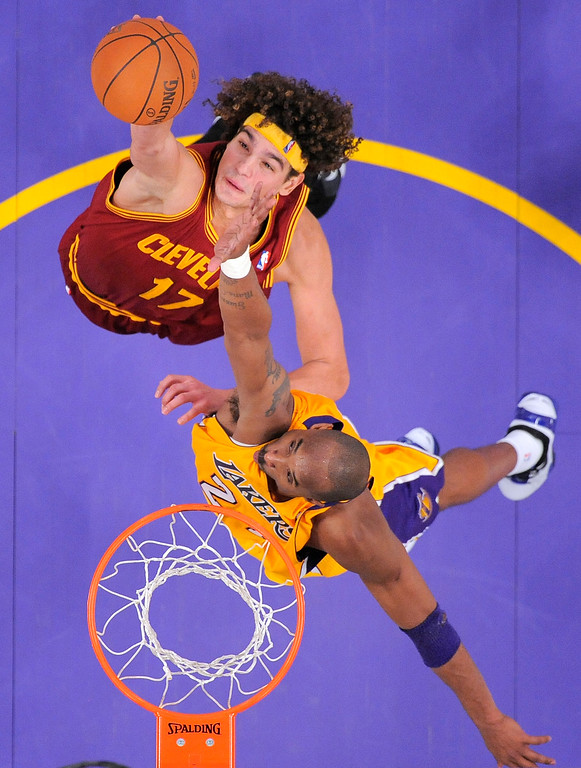 . Cleveland Cavaliers power forward Anderson Varejao, top, of Brazil puts up a shot as Los Angeles Lakers shooting guard Kobe Bryant defends during the second half of their NBA basketball game, Friday, Jan. 13, 2012, in Los Angeles. The Lakers won 97-92. (AP Photo/Mark J. Terrill)