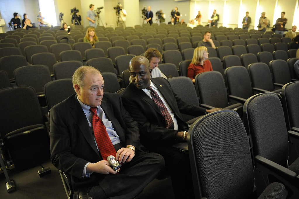 . Dean Singleton and Greg Moore wait for the start of the press conference at the DNA Building. E.W. Scripps Company announced that the Rocky Mountain News, in Denver, Colo., will close and Friday, February 27, 2009, will be the final edition of the newspaper. (Craig F. Walker)