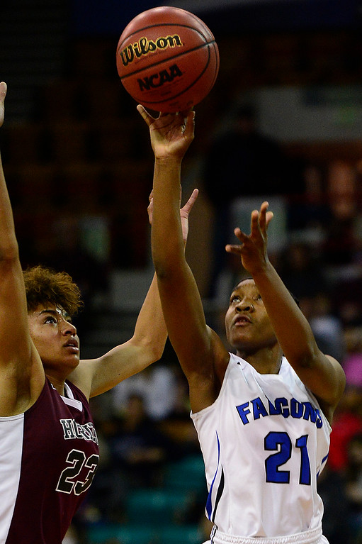 . Horizon guard Isabella Allen (23) tries to block a layup from Highlands Ranch point guard Symone Starks (21) during the first quarter  at the Denver Coliseum on March 4, 2016 in Denver, Colorado. Highlands Ranch defeated Horizon 65-35 to advance to the semifinals of girls 5A basketball tournament. (Photo by Brent Lewis/The Denver Post)