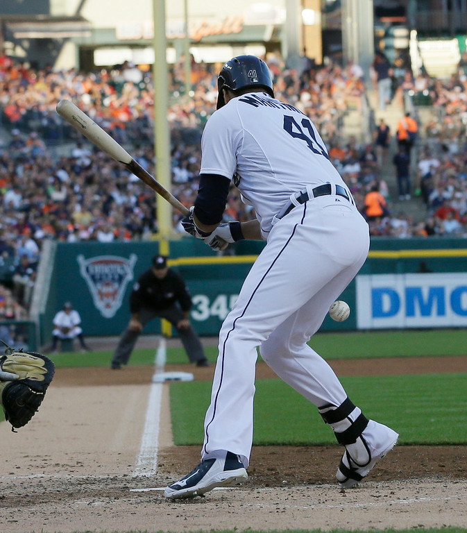 . Detroit Tigers designated hitter Victor Martinez is hit in the thigh during the fourth inning of a baseball game against the Tampa Bay Rays in Detroit, Friday, July 4, 2014. (AP Photo/Carlos Osorio)