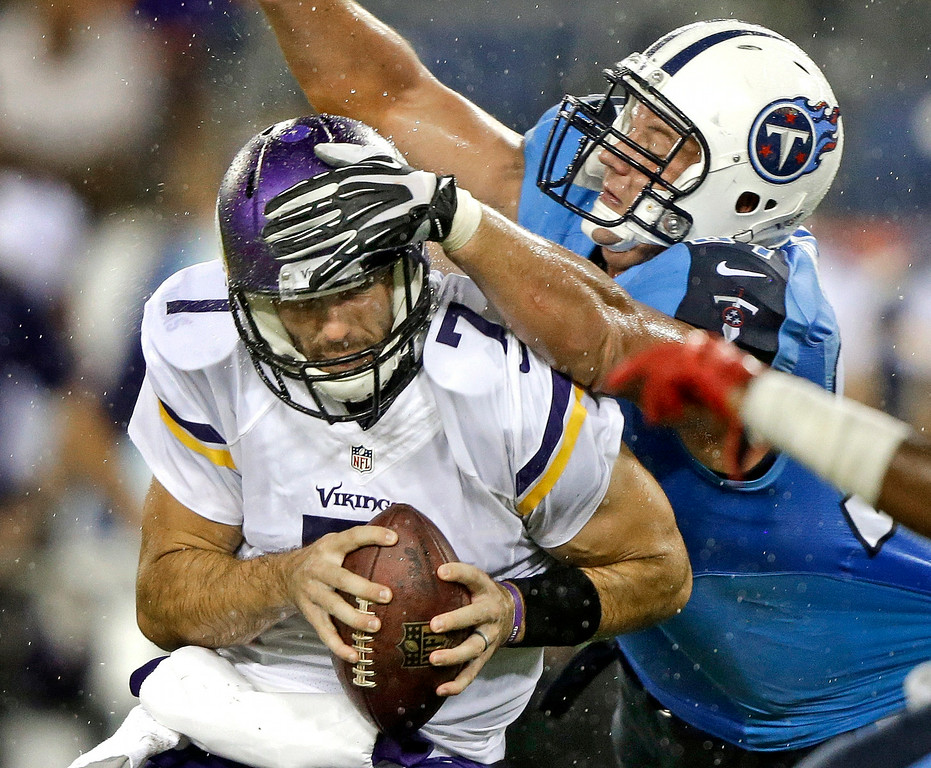 . Minnesota Vikings quarterback Christian Ponder is hit by Tennessee Titans defensive end Karl Klug, right, as Ponder is sacked for a 6-yard loss in the second quarter. (AP Photo/Wade Payne)