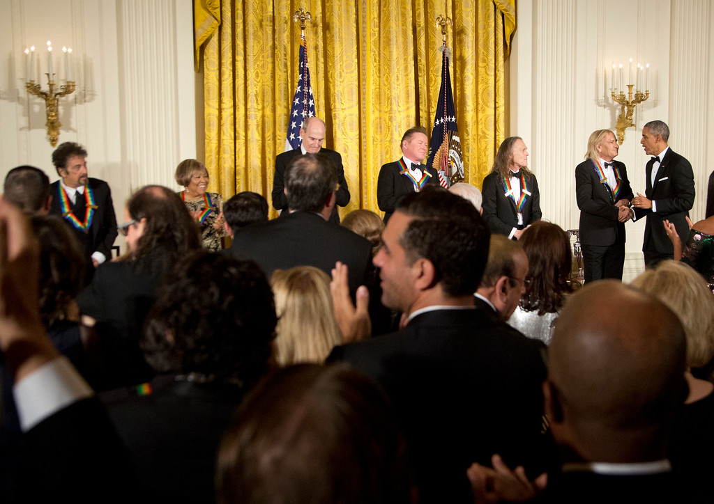 . President Barack Obama, right, congratulates the recipients of the 2016 Kennedy Center Honors, from left, Argentine pianist Martha Argerich, actor Al Pacino, gospel and blues singer Mavis Staples, musician James Taylor, and members of the rock band the Eagles, Don Henley, Timothy Schmit, and Joe Walsh, during a reception in their honor in the East Room of the White House in Washington, Sunday, Dec. 4, 2016, hosted by the president and first lady Michelle Obama. (AP Photo/Manuel Balce Ceneta)
