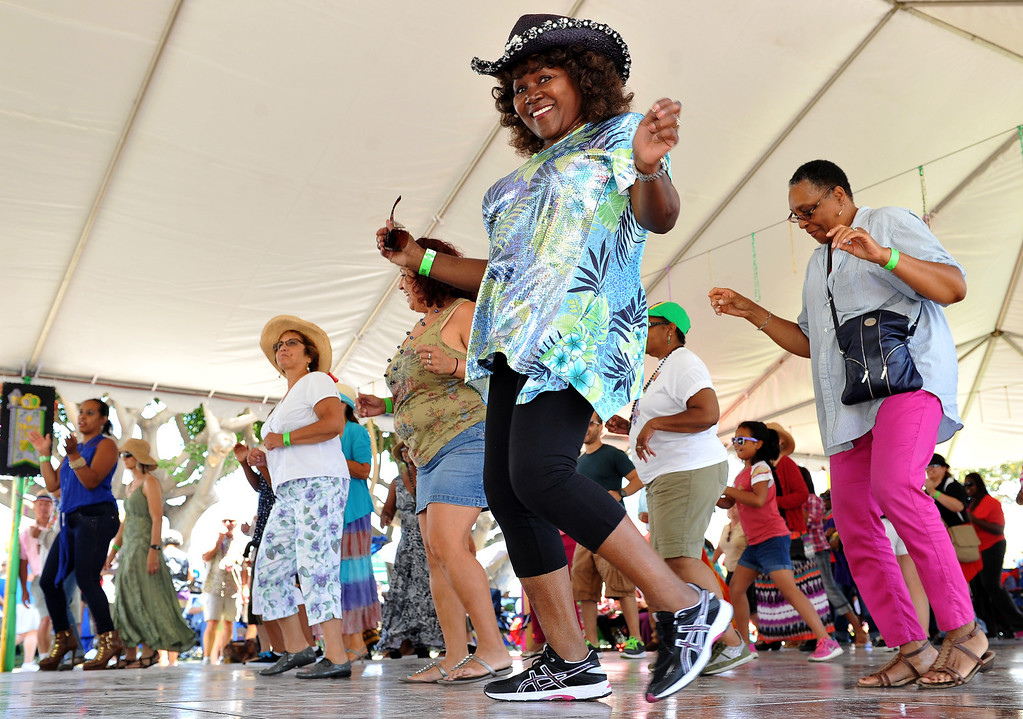 """. 6/22/13 - Beatrice \""""QB\"""" Smith puts some energy into Zydeco Fitness on the dance floor during the  27th Annual Long Beach Bayou and Blues Festival at Rainbow Harbor. Photo by Brittany Murray / Staff Photographer"""