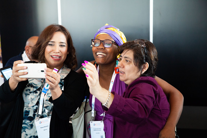 The Netherlands, Amsterdam, 22-7-2018. Audience, speakers and discussion of TB2018. Thrtee women shooting a selfy at the conference.Photo: Rob Huibers for IAS. High resolution file.(Please publish always with complete attribution).